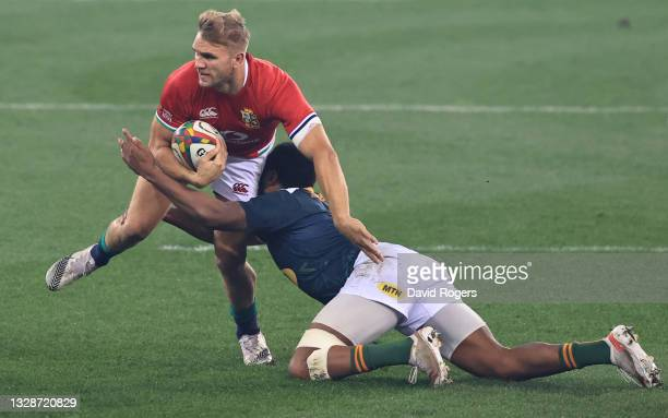 British & Irish Lions centre Chris Harris breaks the tackle of South Africa A centre Lukhanyo Am during the match between South Africa A and the...