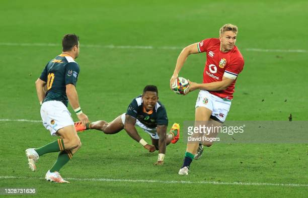 British & Irish Lions centre Chris Harris breaks the tackle of South Africa A wing Sbu Nkosi during the match between South Africa A and the British...