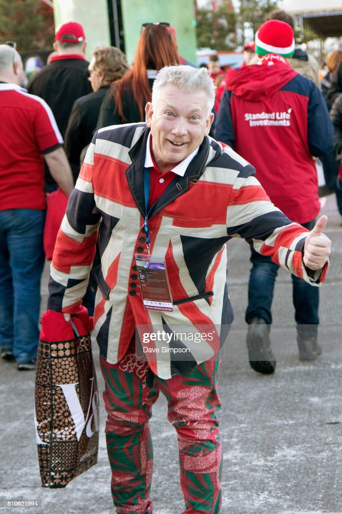 British & Irish Lions fan wearing a Union Jack jacket gets ready to watch the Rugby Test match between the New Zealand All Blacks and the British & Irish Lions at Auckland's Queens Wharf Fanzone on July 8, 2017 in Auckland, New Zealand.