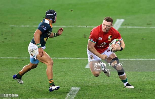 British & Irish Lions player Sam Simmonds runs at South Africa A wing Cheslin Kolbe during the match between South Africa A and the British and Irish...