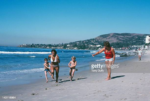 British javelin thrower Fatima Whitbread training with her coach and adoptive mother Margaret Whitbread on the beach in Florida November 1979 Helping...