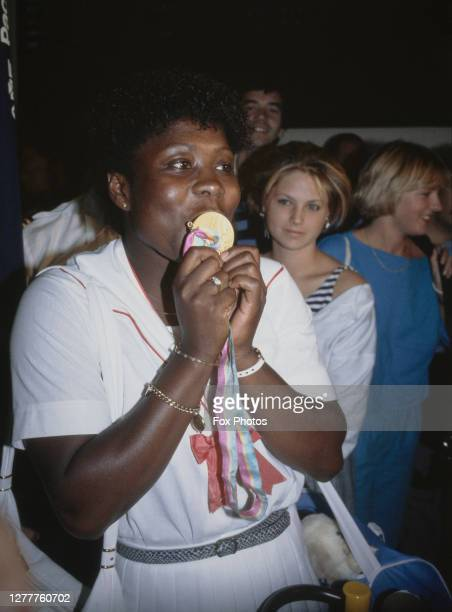 British javelin thrower Tessa Sanderson returns from the 1984 Summer Olympics in Los Angeles with a gold medal, Heathrow Airport, London, 1984.