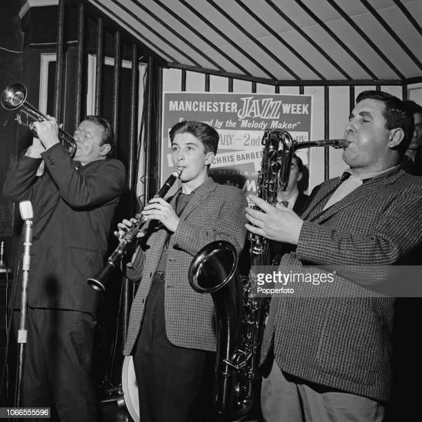 British jazz musicians from left trumpet player Humphrey Lyttelton clarinet player Tony Coe and saxophonist Joe Temperley perform together on stage...