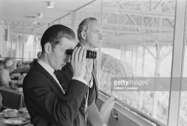 British jockey Lester Piggott watching racing with Irish/British horse racing commentator for the BBC and journalist Peter O'Sullevan at Laurel Park...