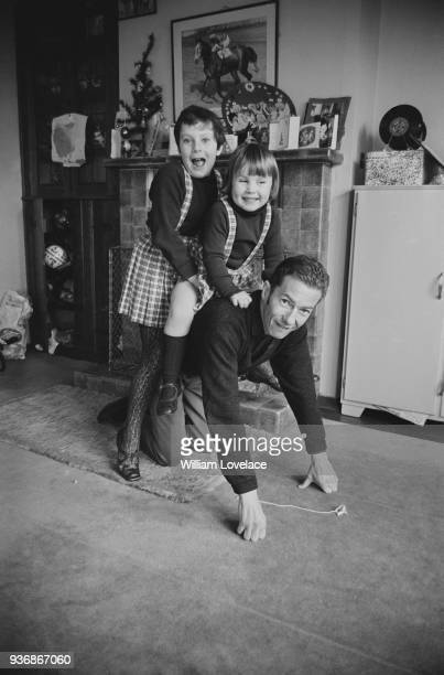 British jockey Lester Piggott with his daughters Tracey and Maureen at his Newmarket home Suffolk UK 19th December 1968