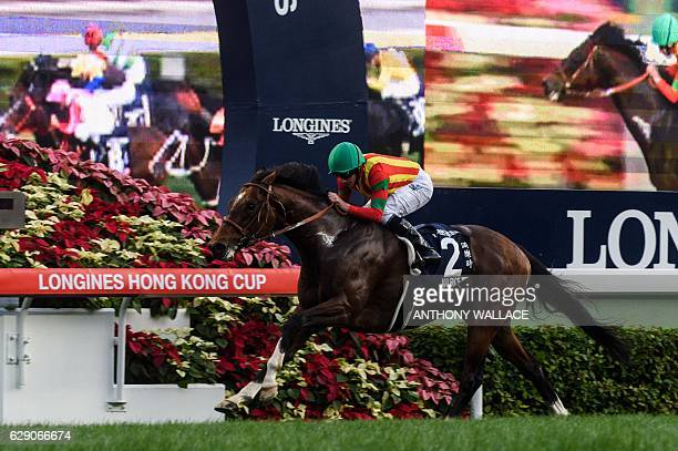 British jockey Ryan Moore riding Japans superstar horse Maurice wins the 2000metre Hong Kong Cup race at Sha Tin Racecourse in Hong Kong on December...