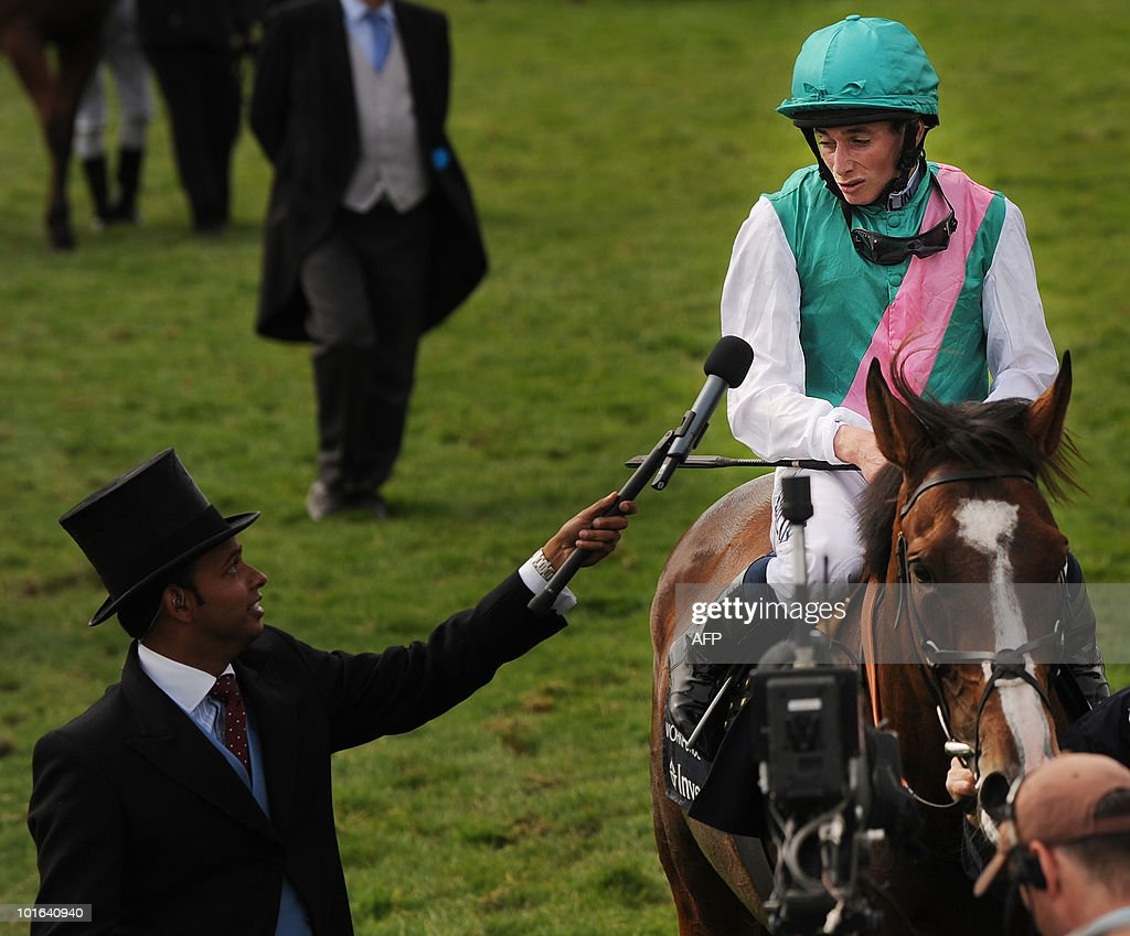 British jockey Ryan Moore (R) speaks to the media after winning the Derby riding Workforce on the second day of the Epsom Derby, in Surrey, southern England, on June 5, 2010.