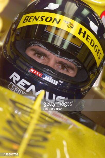 British JordanMugenHonda driver Damon Hill sits in his car in the pits of the racetrack during the third free practice session in Spielberg 24 July...