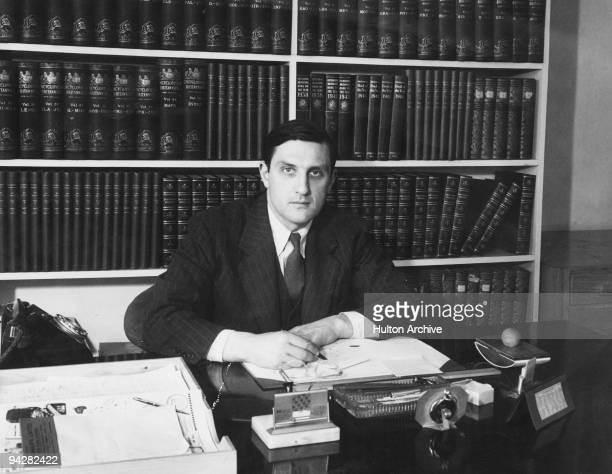 British journalist and Assistant Editor of the Encyclopaedia Britannica William Clarke at his desk 1947