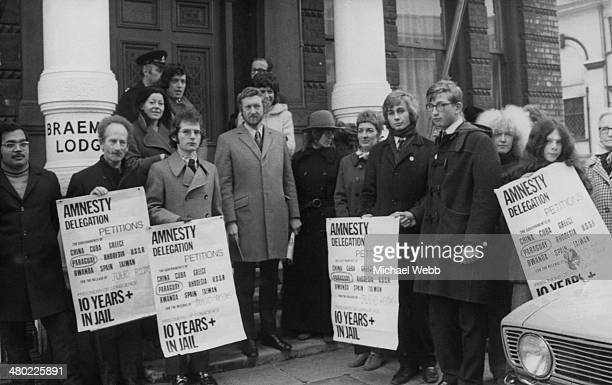 British journalist and author Anthony Grey leading a protest by members of the human rights organisation Amnesty International outside the Paraguayan...