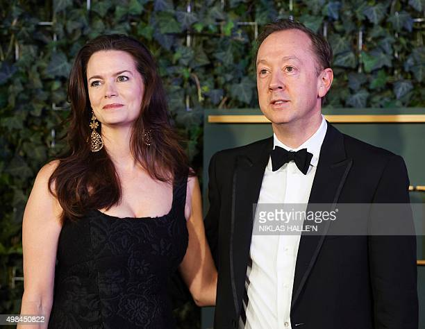 British journalist and current editor of the The Mail on Sunday newspaper Geordie Greig and his wife Kathryn Terry pose on the red carpet as they...