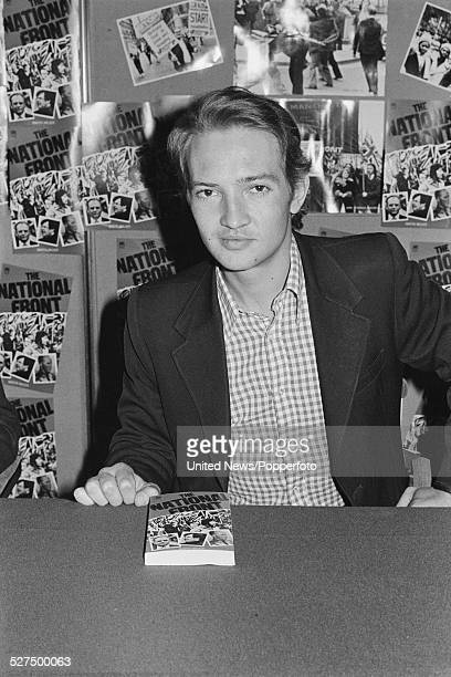 British journalist and writer Martin Walker pictured with a copy of his book The National Front at a book signing event in London on 13th May 1977