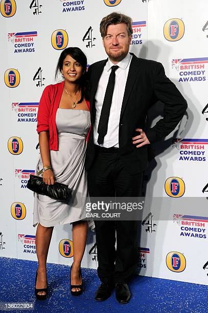 British journalist, comic writer and broadcaster, Charlie Brooker, and his wife, television presenter Konnie Huq, pose at the British Comedy Awards...