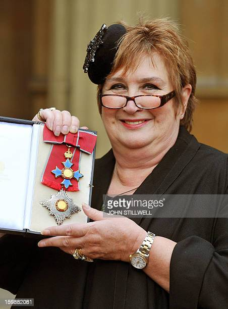 British journalist Jenni Murray poses with her medal after she was appointed Dame Commander of the Order of the British Empire during an investiture...