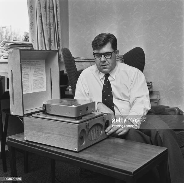 British journalist Peter Fairley , the science correspondent for the Evening Standard, tests out a multi-track tape machine for talking books, from...