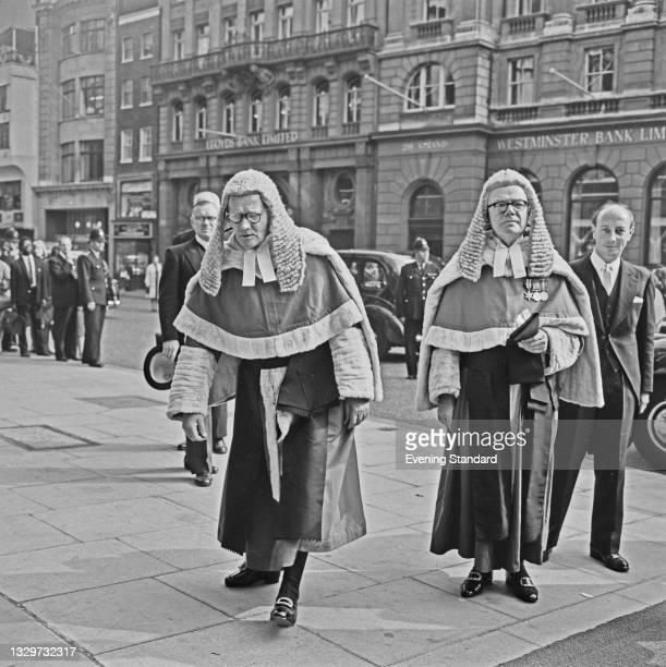 British judges Sir Gilbert Paull and Sir Aubrey Melford Stevenson outside the Royal Courts of Justice on the Strand in London, UK, 14th October 1964.