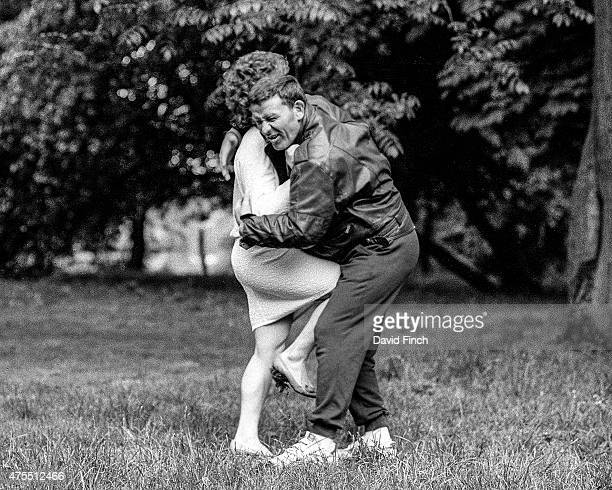 British Judo coach Roy Inman who was later awarded an OBE suffers an agonising attack by judo World champion Ann Hughes during a photo shoot for the...