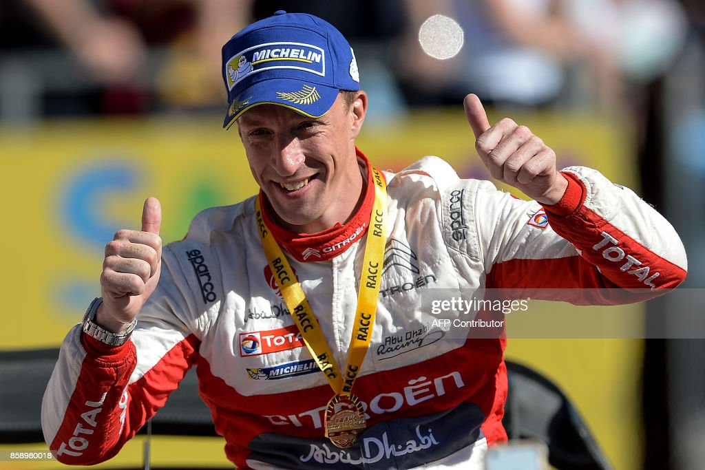 British Kris Meeke celebrates on the podium after winning the 53th Rally of Catalonia in Salou near Tarragona on October 8, 2017. Meeke bagged his second win of the season at the Rally of Catalonia as France's Sebastian Ogier took a big step towards a fifth straight world title. / AFP PHOTO / Josep LAGO