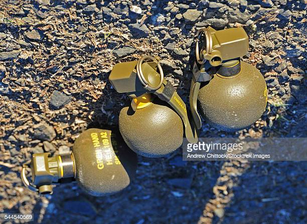 british l2 hand grenades primed ready to use. - hand grenade stock pictures, royalty-free photos & images