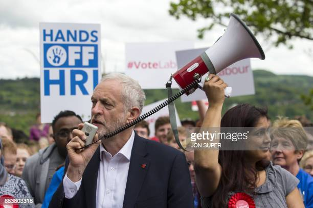 British Labour leader Jeremy Corbyn speaks to supporters during a rally at Beaumont Park in Huddersfield West Yorkshire on May 16 2017 / AFP PHOTO /...