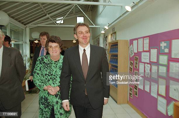 British Labour Leader of the Opposition Tony Blair at a party function 1995 In the background is Blair's spokesman Alastair Campbell