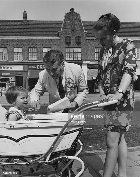 British Labour Party candidate for Ealing North William Molloy Baron Molloy meeting oneyearold Emma and her mother Jill Whitten during his election...
