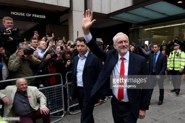 British Labour Party Leader Jeremy Corby greets people as he departs Labour Party Headquarters on June 9 2017 in London United Kingdom After a snap...