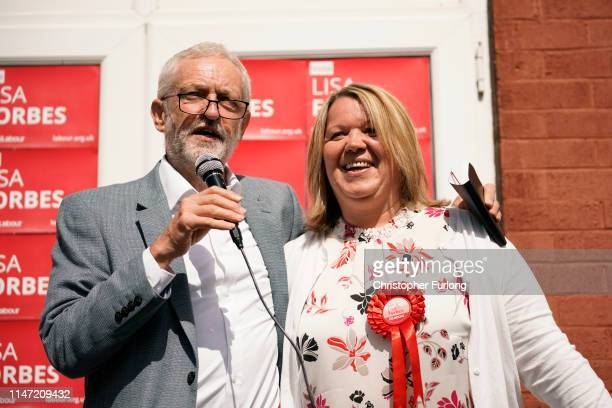 British Labour Party leader Jeremy Corbyn and the party's prospective parliamentary candidate Lisa Forbes talk to supporters in the run up to the...