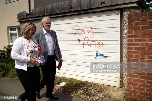 British Labour Party leader Jeremy Corbyn and the party's prospective parliamentary candidate Lisa Forbes take part in a walkabout in the run up to...