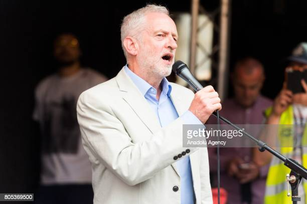 British Labour party leader Jeremy Corbyn makes a speech to protesters during a national demonstration calling for the resignation of British Prime...