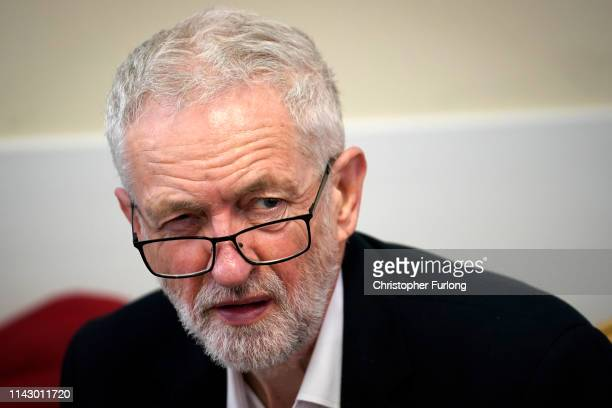 British Labour Party leader Jeremy Corbyn takes part in a round table discussion with local residents at St Ambrose Church Hall on April 16 2019 in...
