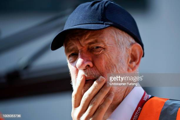British Labour Party leader Jeremy Corbyn tours the Bombardier train manufacturing site on July 25 2018 in Derby England Corbyn toured Bombardier to...
