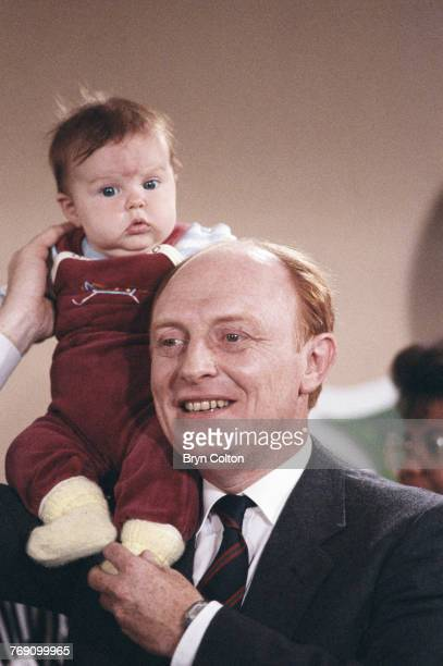British Labour Party leader Neil Kinnock holding a baby during the 1987 general election campaign Bristol 3rd June 1987