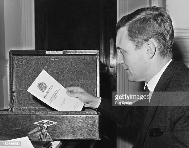 British Labour Party MP Tony Benn places an official report on broadcasting into his dispatch box on his first day in his new cabinet role of...