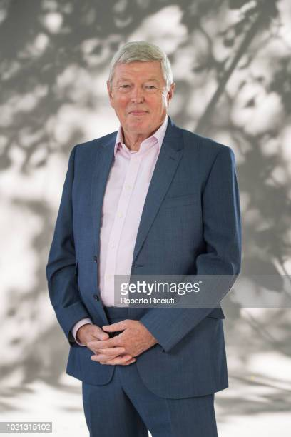 British Labour Party politician Alan Johnson attends a photocall during the annual Edinburgh International Book Festival at Charlotte Square Gardens...