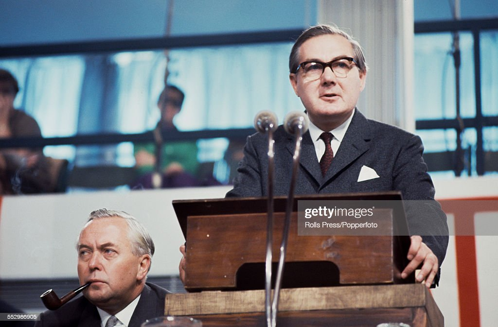 British Labour Party politician and Chancellor of the Exchequer, James Callaghan (1912-2005) pictured speaking from the lectern at the Labour Party annual conference in Brighton on 5th October 1966. Prime Minister Harold Wilson (1916-1995) sits to left smoking a pipe.