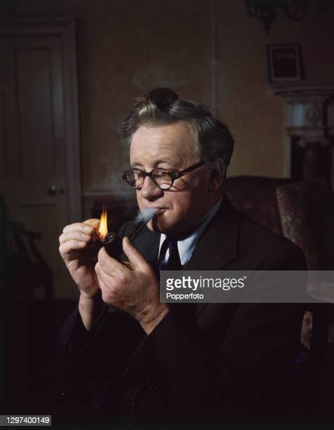 British Labour Party politician and Deputy Prime Minister Herbert Morrison lights a pipe in a living room in England in September 1947.