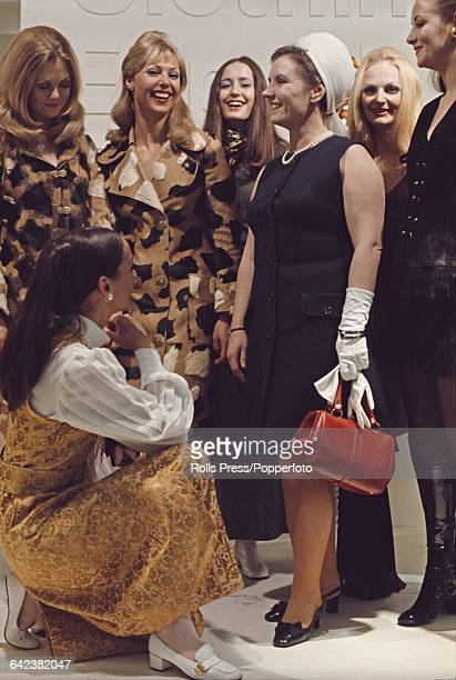 British Labour Party politician and Junior Minister at the Board of Trade, Gwyneth Dunwoody talks with models on a British export clothing stand at a...