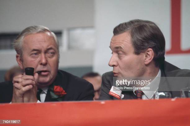 British Labour Party politician and Leader of the Opposition Harold Wilson pictured on left talking with Chairman of the Labour Party Tony Benn on...