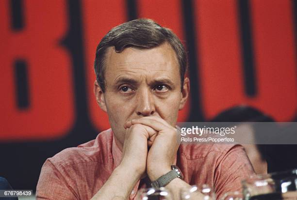 British Labour Party politician and Member of Parliament for Bristol South East Tony Benn listens to a speech on the platform at the Labour Party...