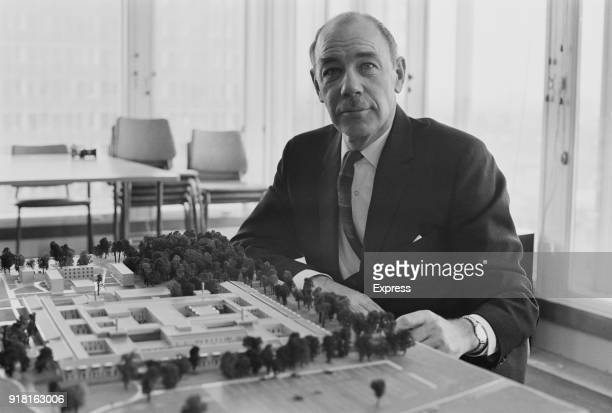 British Labour Party politician and Minister of Health Kenneth Robinson inspects model of hospital to be built in Bury St Edmunds, Suffolk and in...