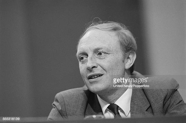 British Labour Party politician and new Leader of the Labour Party Neil Kinnock pictured sitting on the platform at the annual Labour Party...