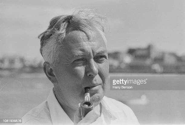 British Labour Party politician and Prime Minister of the United Kingdom Harold Wilson smoking a pipe while on holiday Isles of Scilly UK 15th August...