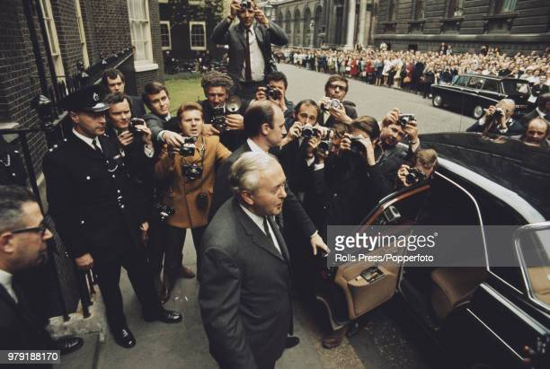 British Labour Party politician and Prime Minister of the United Kingdom Harold Wilson pictured leaving 10 Downing Street in London to meet with the...