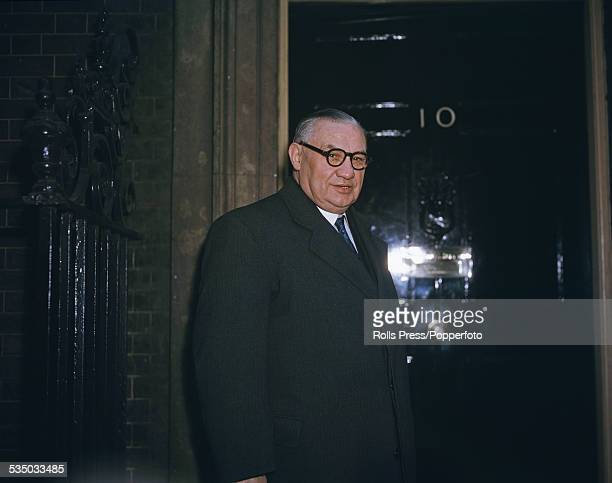 British Labour Party politician and Secretary of State for Foreign Affairs Ernest Bevin pictured standing at the door of No 10 Downing Street in...