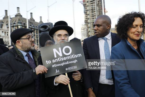 British Labour Party politician David Lammy joins members of the Jewish community holding a protest against Britain's opposition Labour party leader...
