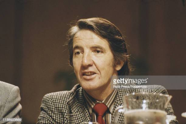 British Labour Party politician Dennis Skinner listens to a speech whilst seated on the platform at the Labour Party annual conference in Brighton...