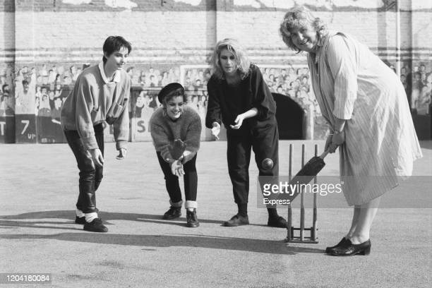 British Labour Party politician Frances Morrell , leader of the Inner London Education Authority, with British pop group Bananarama playing cricket...