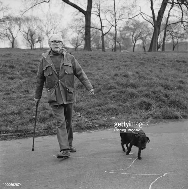 British Labour Party politician Michael Foot walking his dog on Hampstead Heath, London, England, March 1976.