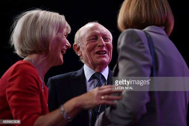 British Labour Party Politician Neil Kinnock speaks with coparty politician Harriet Harman as his wife Glenys Kinnock looks on at Manchester Central...